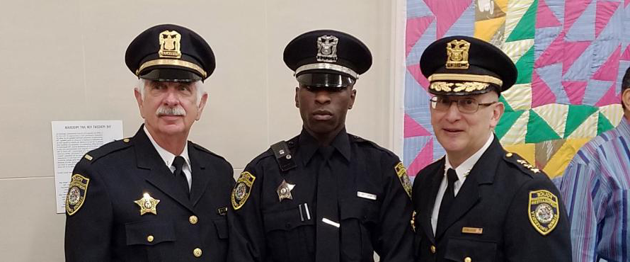 New officers pose in uniform.